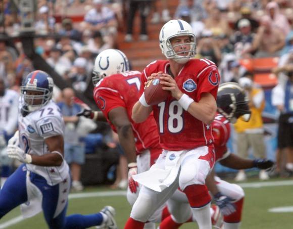 Peyton Manning dropping back to pass