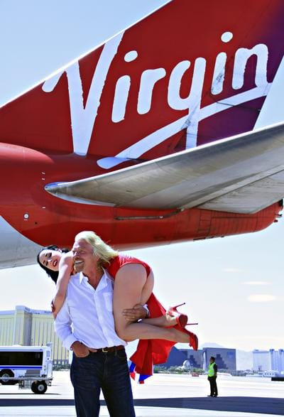 Richard Branson, a whiner running down the road with a billion dollar cheque
