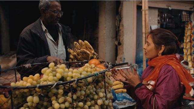 Man and woman on the fruit market in Kathmandu, Nepal