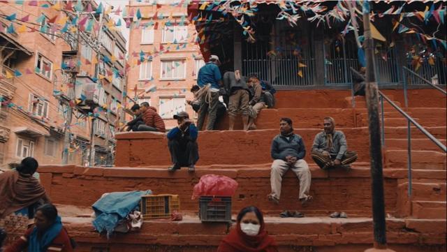 People sitting on the street stairs in Kathmandu, Nepal
