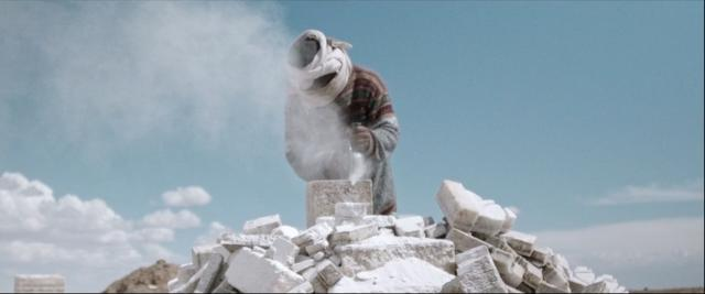 Nico at work, sawing the salt-cat at Uyuni Salt Flats in Bolivia