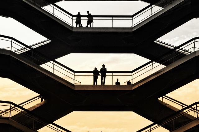 Silhouettes of people inside a building