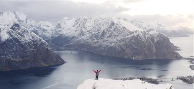 David Jervidal's father standing on a cliff in Lofoten, Norway