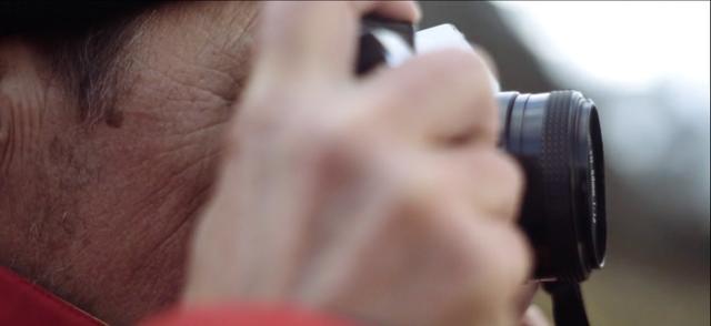 Detail of David Jervidal's father shooting a photograph with analogue camera
