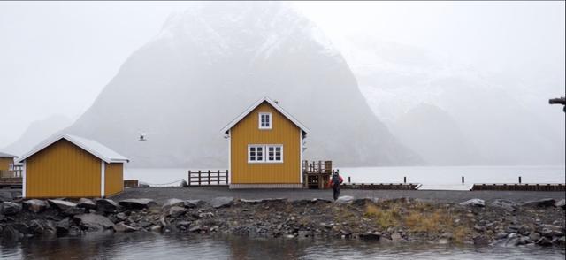A yellow beachside cabin in Lofoten, Norway