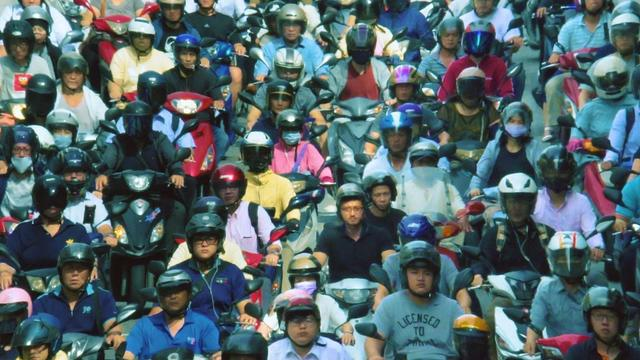 A mass of Taiwanese motorbikers on the road
