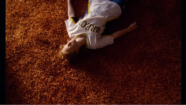 A girl laying on a brown carpet