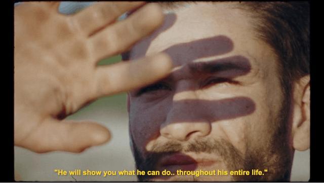 Sebastien looking towards the sun through his fingers