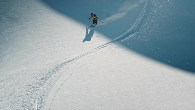 Sam Favret skiing down in the Chamonix area on a sunny day