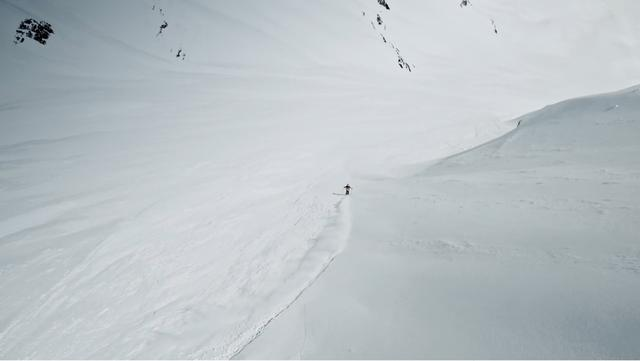 Sam Favret skiing down a steep slope in the Chamonix area, Mont Blanc