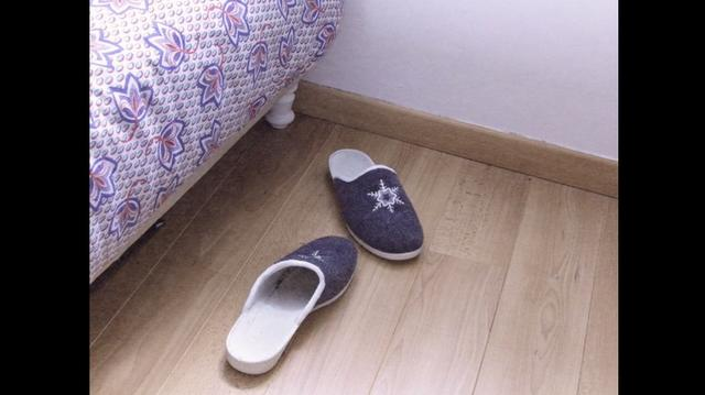 Slippers on the wooden apartment floor