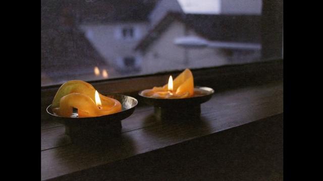 Lightning candles on a windowsill