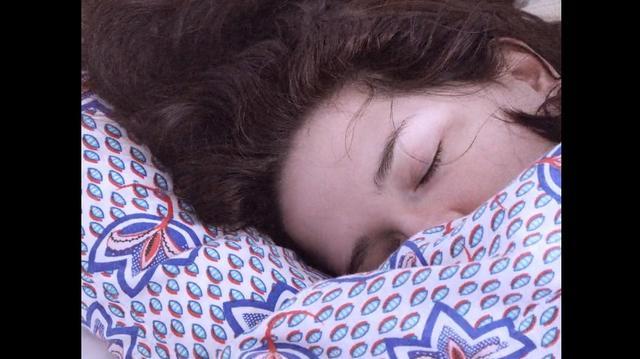 Detail of Charlotte Arene's head sleeping