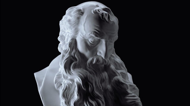 a classical white sculpture on a black background