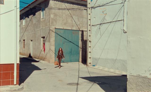 Actress Rachel Lascar walking through the sunny Andalucian streets