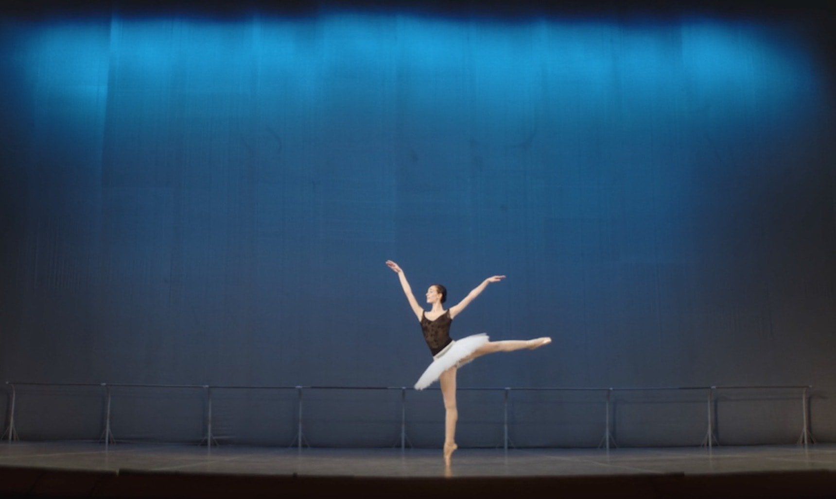 A Russian ballet female dancer rehearsing on a stage