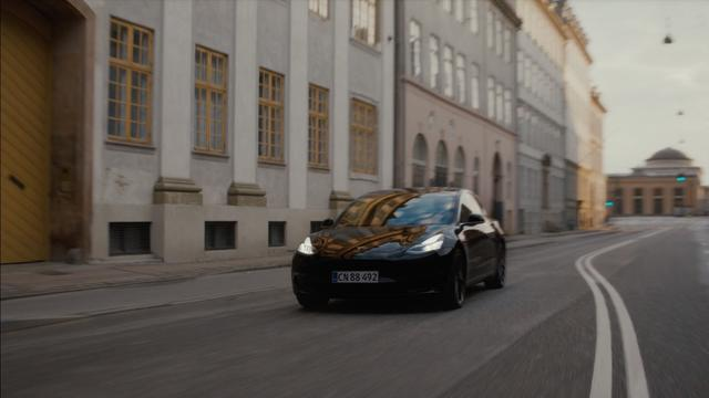 Tesla car on the road in European city